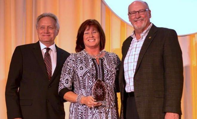 Lagina Fitzpatrick (center) received the prestigious Missouri Division of Tourism Ambassador Award during the 2016 Governor's Conference on Tourism.