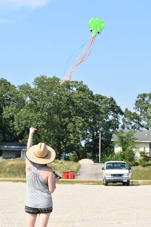 A group of lake area kids put their kite building skills to use with a hands-on workshop recently.