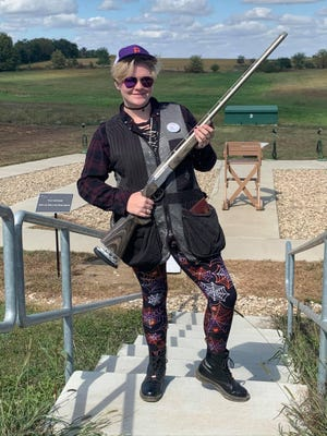 Shown is Lansing incoming senior Sarah Barlow prior to competing with Piper High School's trap shooting team at the state tournament June 20.