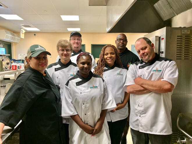 Five determined students graduated from the Food Bank of Delaware's Culinary School in Milford the morning of June 28. From left, front row, Chef Tish Badamshin and graduates Jaden Garrity, Shakhia Truitt, Shalee Murray and Stephen Marinari; back row, graduate Alex DuSold and Chef Tim Hunter.