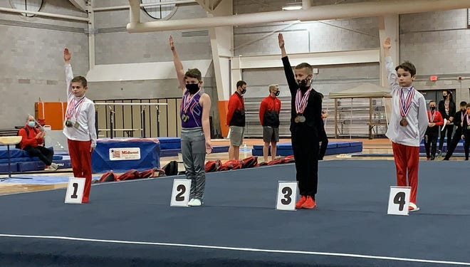 Jerry Sharp Jr., a 10-year-old fourth grader at Ida Elementary, is crowned the 4D1 winner at the Ohio USA Gymnastics Championships recently.
