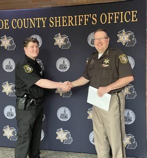 Monroe County Sheriff Troy Goodnough welcomes James McGarry as the newest corrections officer for the county.