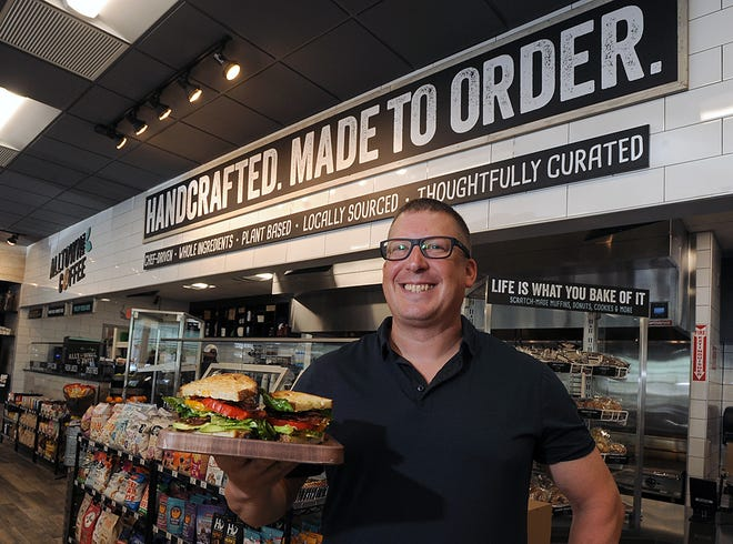 Joshua Smith, director of culinary innovation at Alltown Fresh, holds a BLT sandwich at the newest location at 656 Boston Post Road, Marlborough, June 30, 2021.