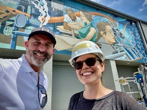 Jim Dodson and Megan Lingerfelt pose in front of the most recent mural on the ORNL Federal Credit Union-owned building at Broadway Avenue in Oak Ridge
