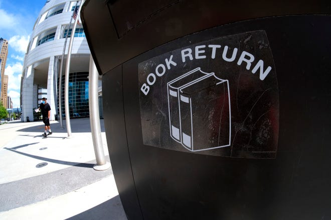 The Metropolitan Library System is eliminating fines for overdue materials for the next year as part of a pilot project. The book return kiosk at the downtown Oklahoma City branch is shown.