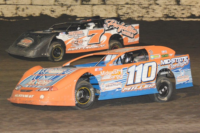 Landen Miller (110) races Steven Mattingly (7) for the lead. Miller took the lead with two laps remaining and won his first career feature race at Fairbury Speedway.