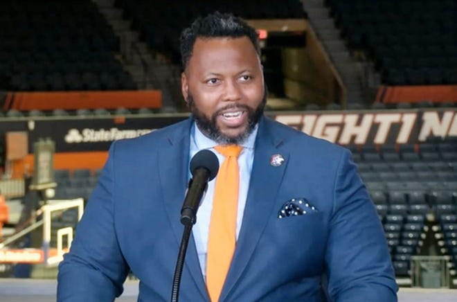 State Rep. Kambium Buckner, D-Chicago, speaks at a news conference at the University of Illinois Tuesday at which the governor signed his bill allowing college athletes to be paid for the use of their name and likeness.