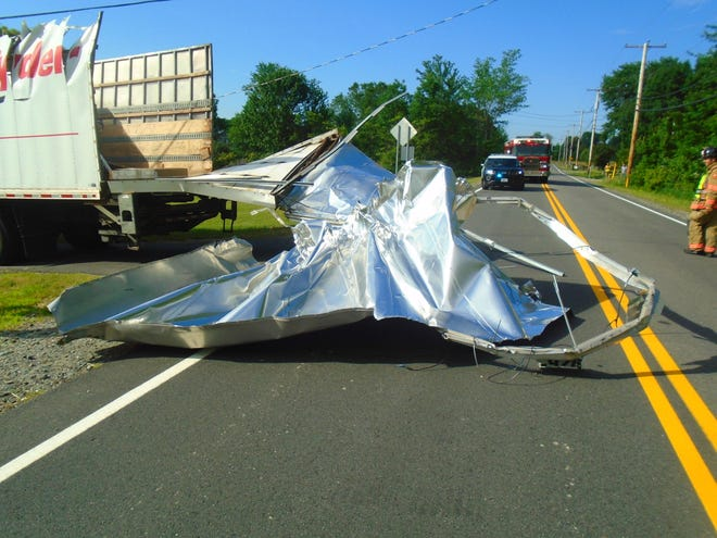 A Ryder rental truck coming from Route 101 into downtown via Newfields crashed into the Pan Am Railroad Bridge and ripped its roof off, causing the road to be closed in both directions for 30 minutes Wednesday morning.