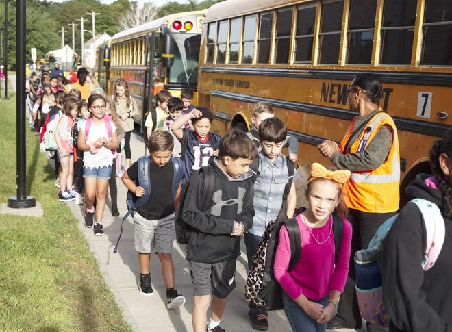 Students will be boarding school buses again this fall, Gov. Dan McKee said Wednesday.