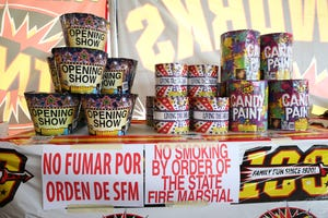 Fireworks for sale at a stand in the parking lot of the Pioneer Plaza Shopping Mall in Springfield.