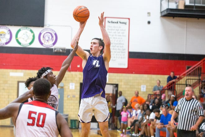 Rockford Lutheran's Garrett Bertrand sinks a 3-pointer at the buzzer to beat East, 61-58, in the championship game of the East Summer League at East High School Tuesday, June 29, 2021, in Rockford.