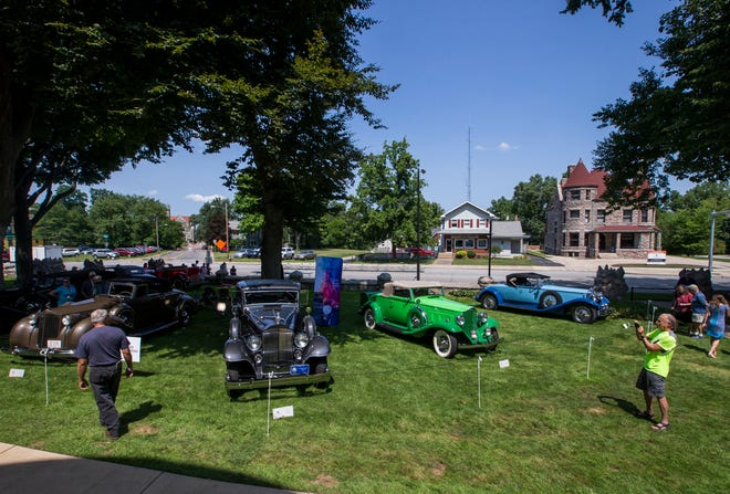 People look at cars on display at the Concours d'Elegance on Aug. 11, 2018, at Copshaholm in South Bend. The annual Studebaker National Museum event returns Saturday after being canceled in 2020 because of the pandemic.