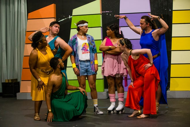"""Aaron Smith, as Thalia, clockwise from bottom left, Angela Blake, as Euterpe, Christian Marquez, as Terpsicore, Zach Wilkeson, as Sonny, Mimi Bell, as Clio, Micah Spiece, as Calliope and April Sellers, as Melpomene, act out a scene during a dress rehearsal for the South Bend Civic Theatre's production of """"Xanadu"""" Tuesday, June 29, 2021 at the South Bend Civic Theatre."""