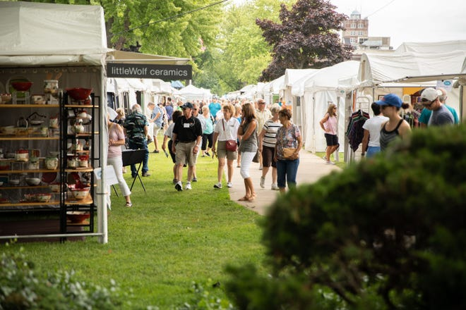 Patrons browse the displays at the 2019 Krasl Art Fair on the Bluff in St. Joseph. The event returns Saturday and July 11 after being canceled in 2020 because of the pandemic.