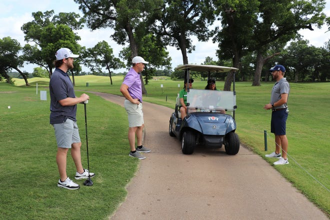 Golfers get ready for a round of golf at the inaugural Cross Timbers Classic charity golf scramble on June 26.