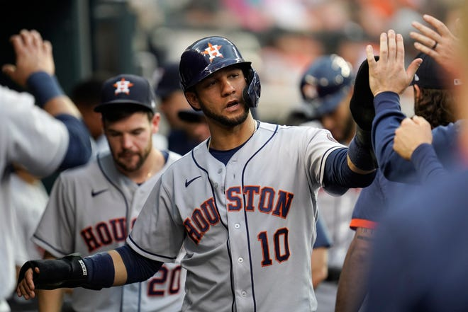 Houston Astros 'Yuli Gurriel (10) celebrates scoring against the Detroit Tigers in the fourth inning of a baseball game in Detroit on June 24.