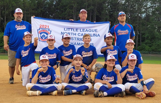 Members of the 11/12 year old Cherryville baseball team celebrate their District I title by posing with the banner after beating Boiling Springs 10-4 on Tuesday. Team members include: Kenan Fowler, Jayden Adams Kayden Smith, Ryder Dellinger, Landon Sain, Canon Whitesides, Trevon Dalton, Cole Carpenter, Tristan Towery and Curtis Kester. Coaches are Tyler Sain, Jason Sain, Tony Owens and Dusty Smith.