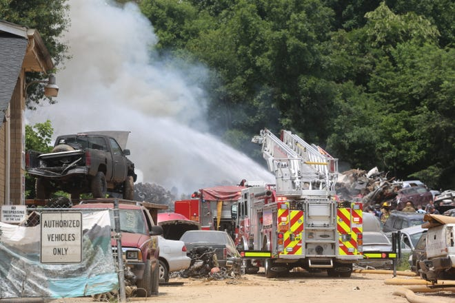 Firefighters worked Wednesday afternoon to contain a fire at L&L U-Pull-It in Shelby.