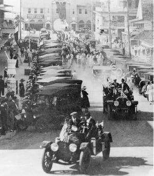 A downtown parade celebrates the official creation of Sarasota County in 1921.