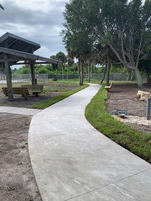 The concete path at Brohard Paw Park is now cooler for pets as well as ADA compliant.