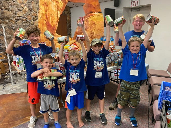 Children at Heritage Church's Vacation Bible School, which met on Wednesday nights in June, collected more than 1,000 canned goods to donate.