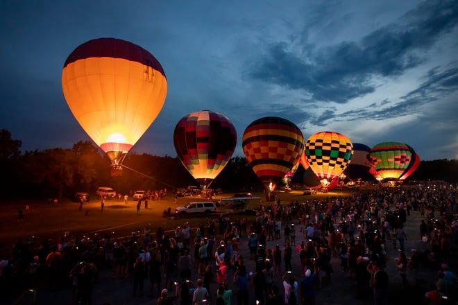 Balloon glow during FireLake Fireflight Balloon Festival in 2018. The festival returns in 2021.