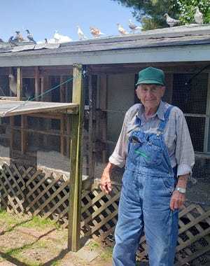 """William """"Bill"""" Lamb, 88, stands next to his pigeon loft located at the back of his property on North Vine Street. Lamb built the loft in 1958 and has been racing pigeons since the 1950s."""