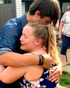 Carissa Kerschner expresses her thanks to Caleb Miller, whose family bought her a car as part of her graduation from Amanda's House.
