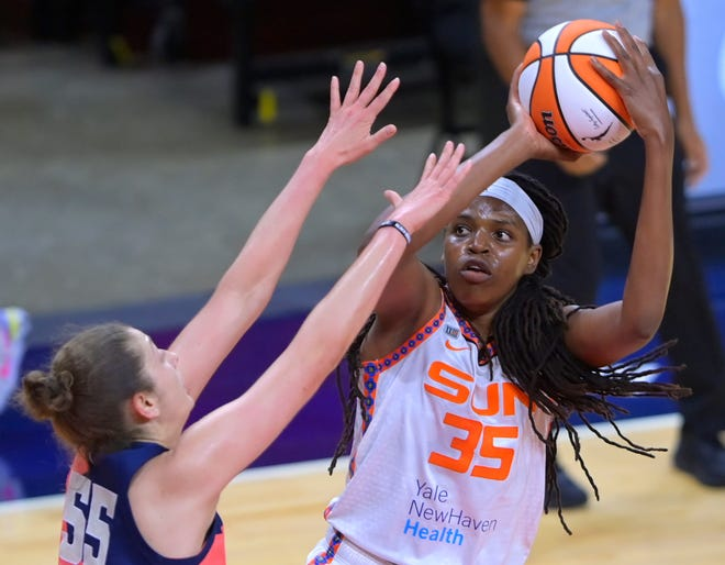 Washington Mystics forward Theresa Plaisance, left, defends against Connecticut Sun forward Jonquel Jones during a WNBA basketball game Tuesday, June 29, 2021, in Washington.