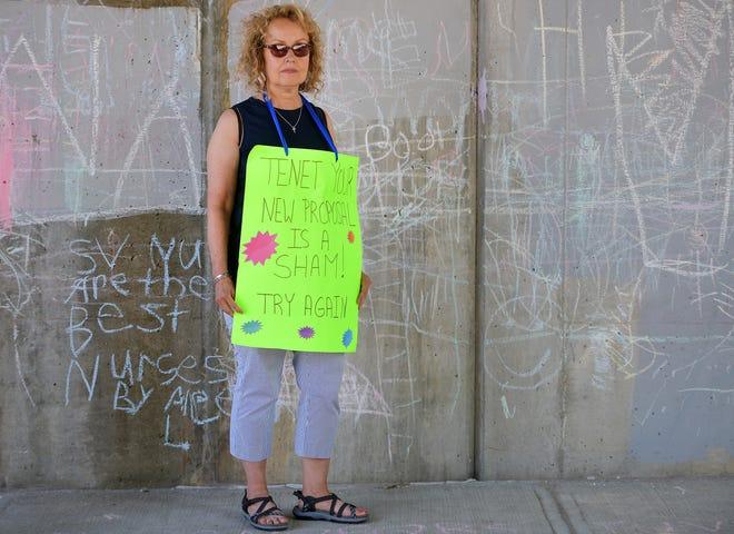 St. Vincent Hospital striking nurse Aimee Albani, near a wall chalked by kids who accompany their parents on the strike line.