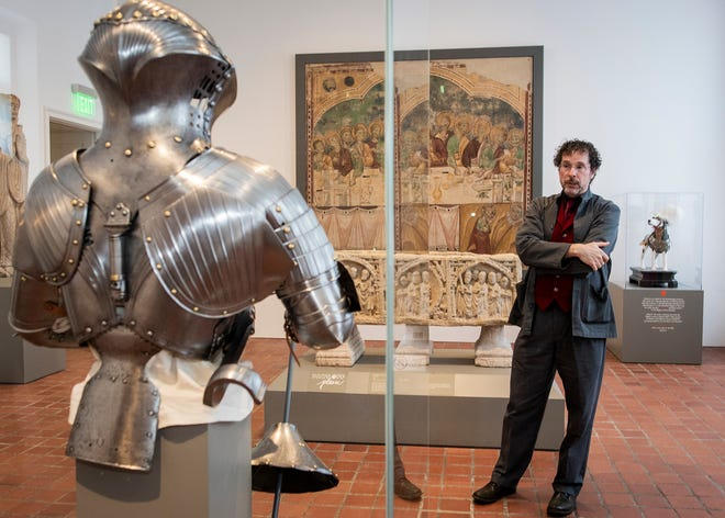 Jeffrey Forgeng is pictured with one of the pieces from the Higgins Armory Collection at the Worcester Art Museum in 2018.