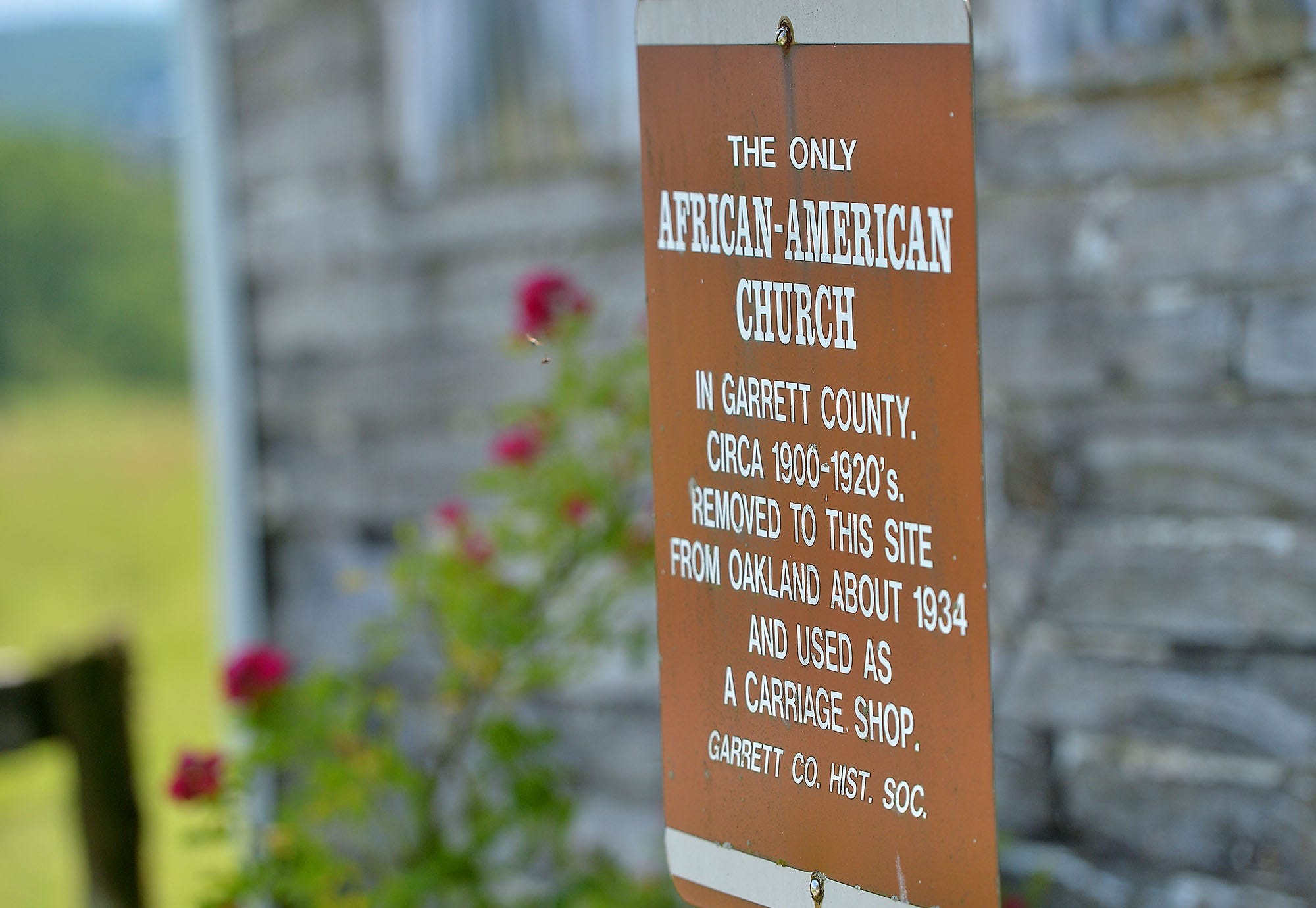 A historical marker, placed by the Garrett County Historical Society, sits outside the Bethel A.M.E. church located on a family farm south of Oakland, Md.