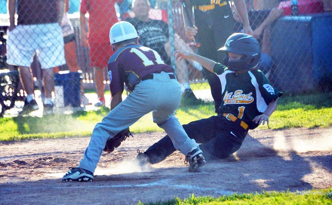 West End's Matthew Penner beats the tag of Maugansville pitcher Hunter Cosey and slides home safely in third inning, scoring on a wild pitch. West End won 12-11 to force a final game in the Maryland District 1 9-11 tournament.