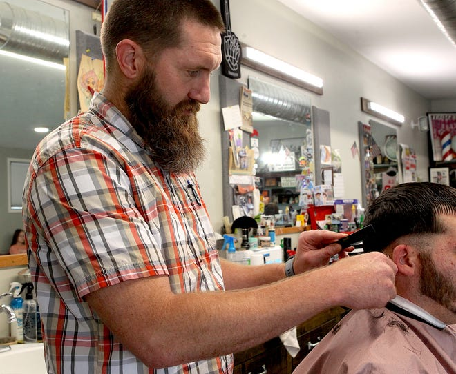 Gavin Steele cuts a customer's hair Monday afternoon.
