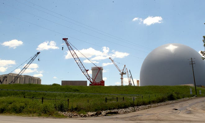 Construction progress at the new Lehigh Cement plant in Mitchell. Shown are the Clinker Dome at the right and the blending silo in the center. The two sky cranes, center right, will be used to build the 400 foot pre-heating tower which should soon begin to rise above the landscape.