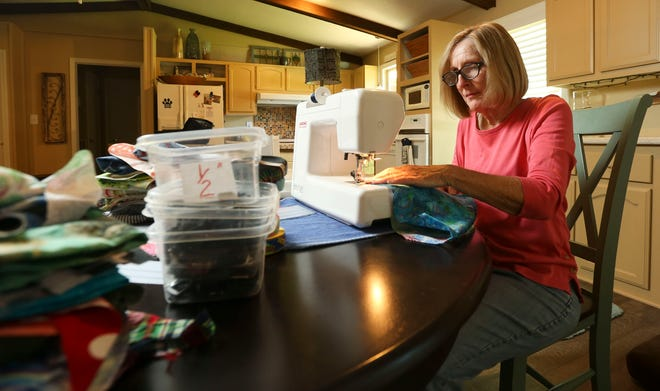 Mary Calhoun makes a variety of accessories for pets at her home in Northport Tuesday, June 30, 2021. [Staff Photo/Gary Cosby Jr.]