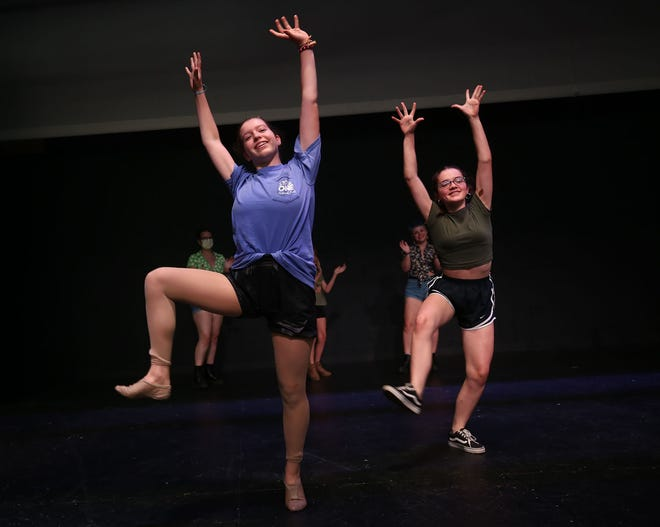 """Westerville South High School senior Madison Banks, as """"Dream Laurey/lead dancer,"""" and Westerville South junior Audrey Mylin, as """"Featured dancer,"""" perform during rehearsal for """"Oklahoma!""""  on June 29. The play consist of actors from all three Westerville high schools and four middle schools. Performances will be at 7 p.m. July 15-18 and 22 and at 8:30 p.m. July 23 at the amphitheater at Alum Creek Park."""