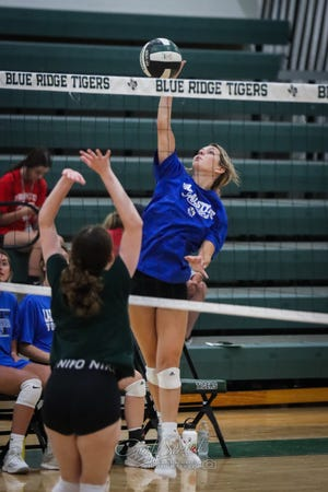 VAHS Senior to be Abby Lange hits for a kill in the summer league game in Blue Ridge