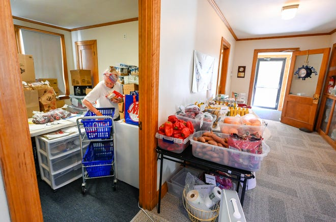 Susan Downs-Cripps, board member, works to fill food orders inside the new location of the Anchor Food Pantry at the old Swampscott Police Station on Monday, June 28, 2021.