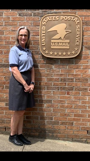 Marjorie List poses outside of Marshall Post Office on June 25. List will retire at the end of July after 31 years working at the post office.