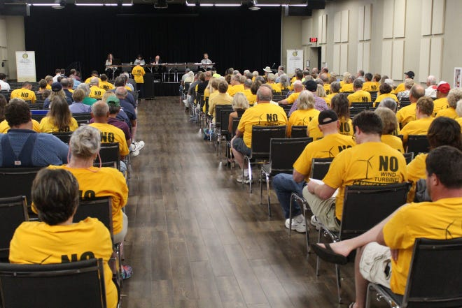 Members of the Seneca Anti-Wind Union, seen here at a 2019 Ohio Power Siting Board public hearing in Tiffin regarding the proposed Republic Wind Farm project, were pleased with the Ohio Legislature's passage of Senate Bill 52. The bill, which goes to Gov. Mike DeWine's desk for approval, would give counties and local communities more input on the siting of proposed wind and solar energy projects.