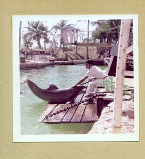 Vincent Formosa eventually got to work with dolphins and was underwater four hours a day.