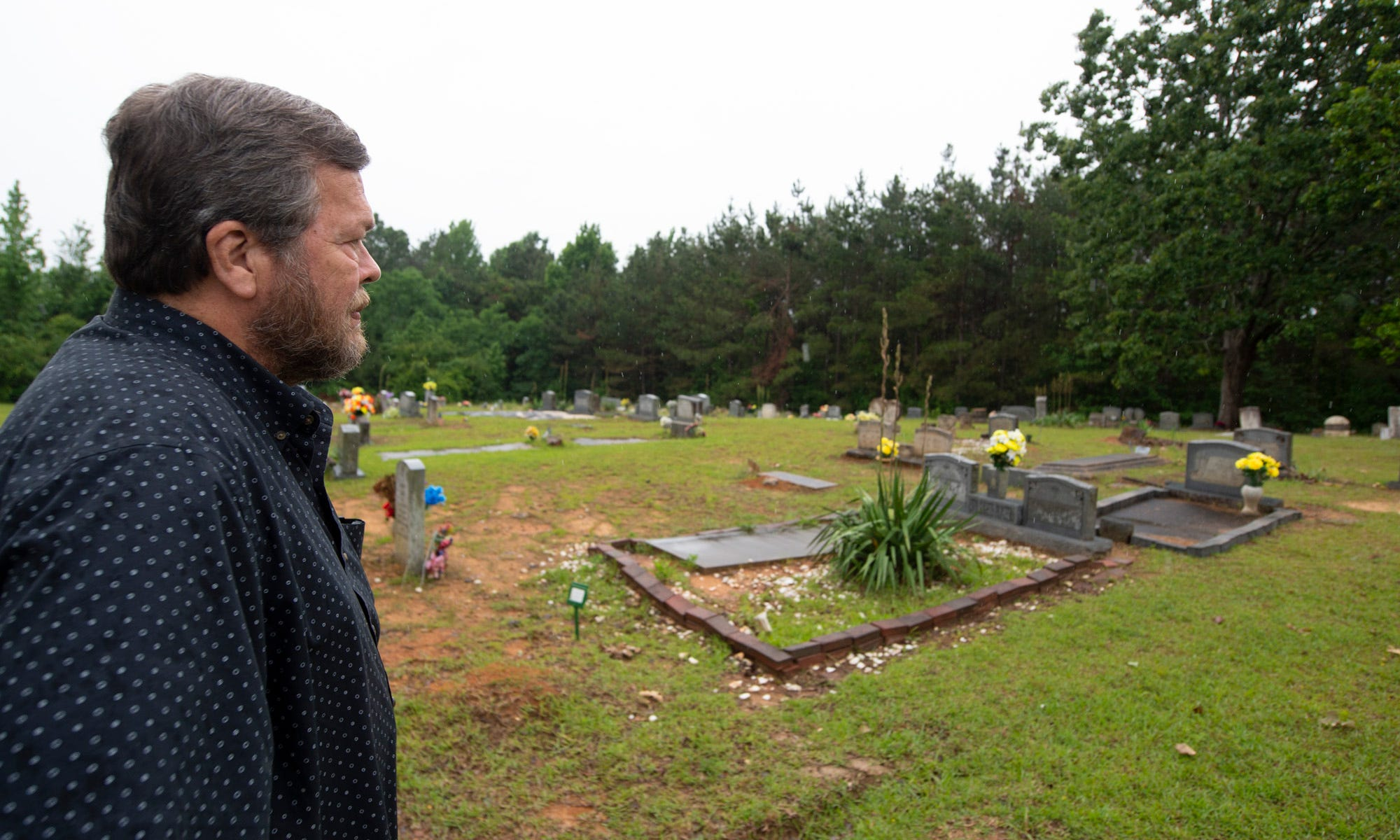 """""""Whenever I get down, I would come out here and walk through the cemetery,"""" Dick Molpus of Philadelphia, Miss., says of Mount Zion United Methodist Church. """"It's kind of hallowed ground. Whatever you were facing, people faced a lot worse."""""""
