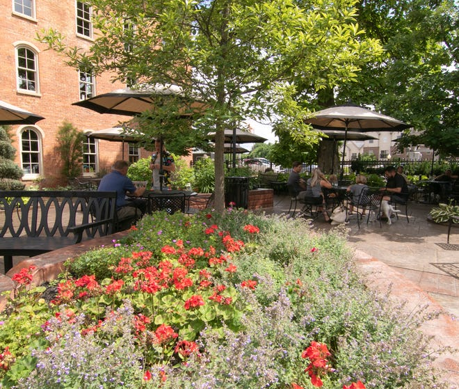 Patrons relax on the patio of Brighton's Brewery Becker Wednesday, June 30, 2021.