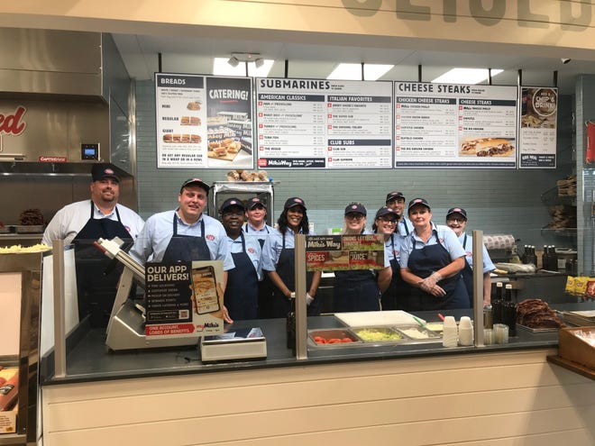 Jersey Mike's Subs, 783 N. Lexington-Springmill Road, opened Wednesday. Ryan Foster, second from left, district manager/,market leader, said the store hired 25 employees at the new business.
