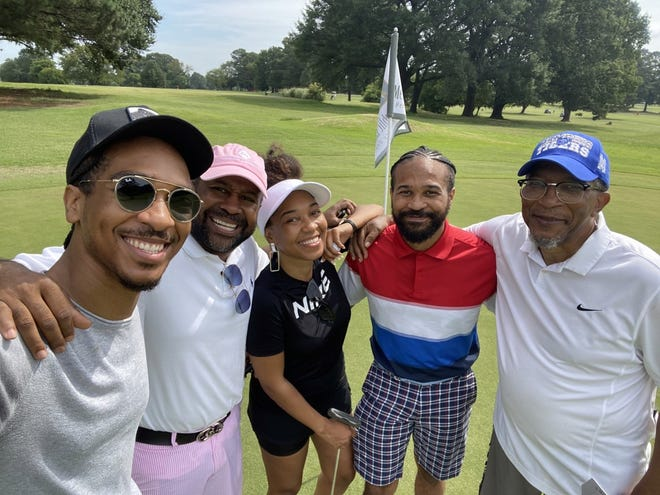 DeWayne Breckenridge (far right) and his children pose during a Father's Day golf outing.