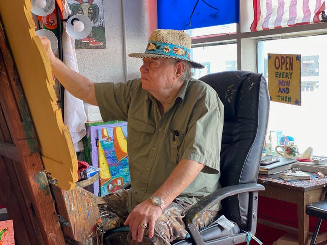 Don Sawyer, the founder of ARTWALK of Wetumpka, paints in his art studio in downtown Wetumpka.
