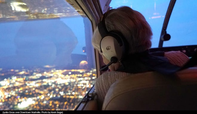 Lydia Gross, age 99, from a plan looks over the Nashville lights