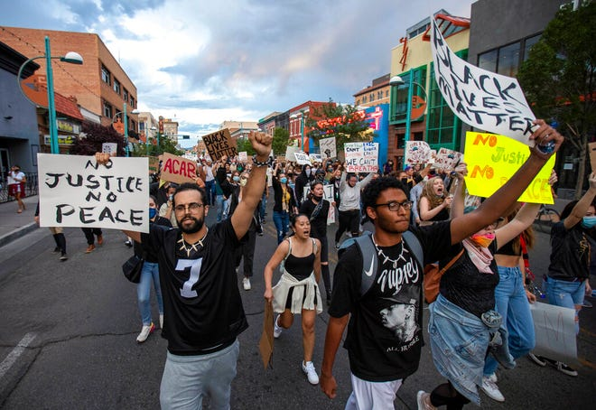 In this May 31, 2021, file photo demonstrators protest the death of George Floyd in downtown Albuquerque. Efforts among a handful of states to hold police accountable for brutality and misconduct are expanding as New Mexico opens the door to civil rights lawsuits in state courts against government agencies.