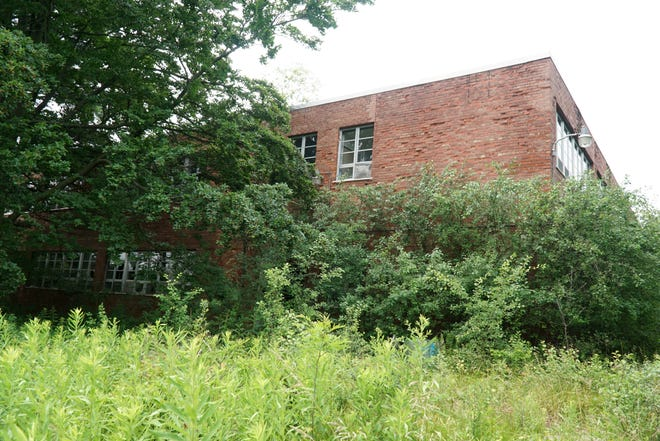 One of the 11 remaining buildings on the grounds of the former Northville Regional Psychiatric Hospital in June of 2021.